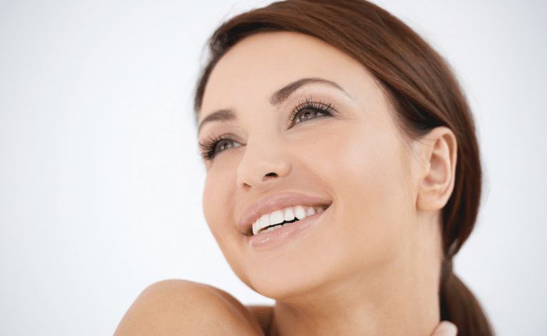 a lady smiling with dental implants